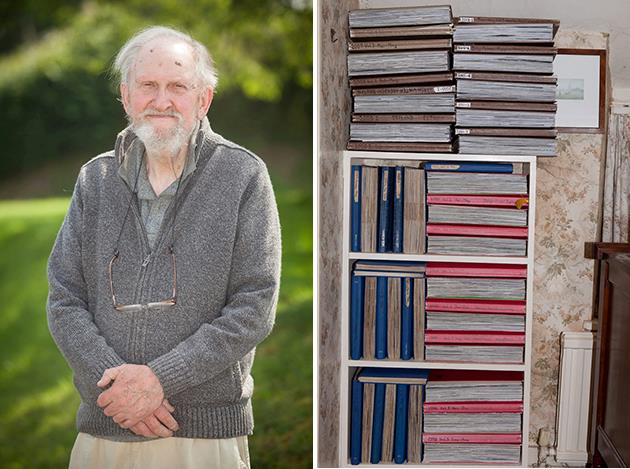 John Gadd stands with the stacked volumes of his diary