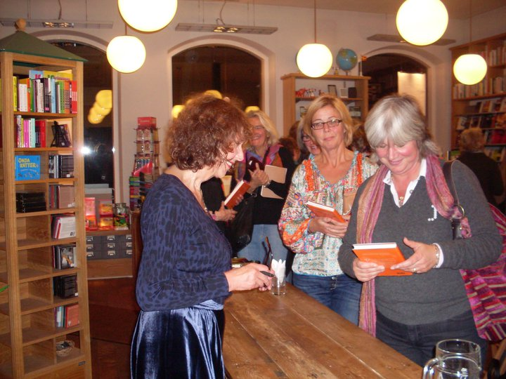 Astrid Seeberger signs books for customers.