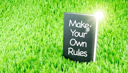 "Shining Black book on grass with "" Rules  "" word, Business and Education concept."