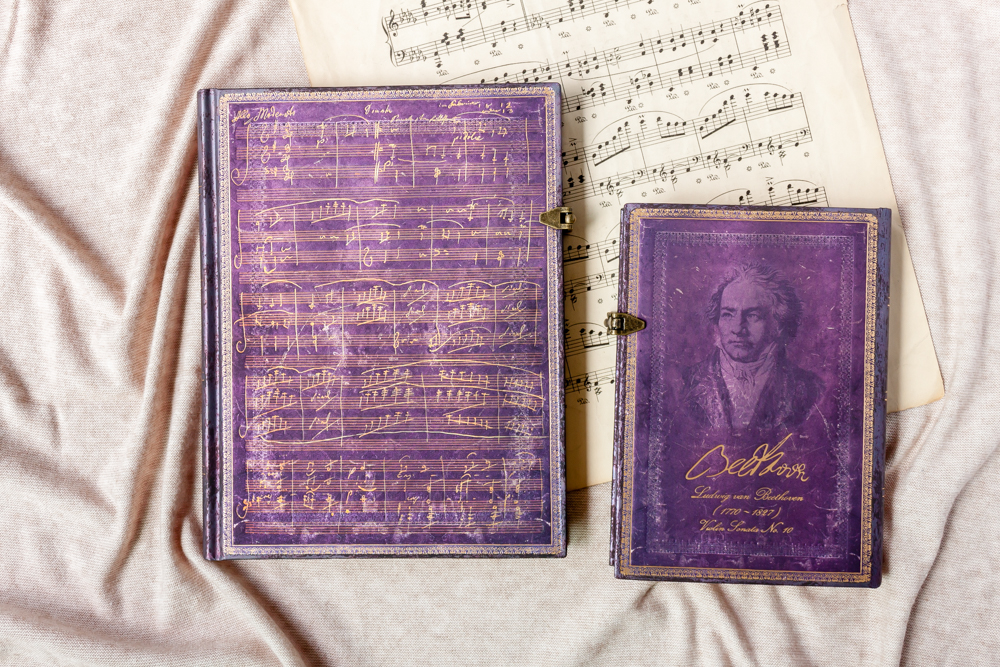 Paperblanks Beethoven's 250th Birthday Special Edition journals featuring a handwritten composition and portrait of Beethoven