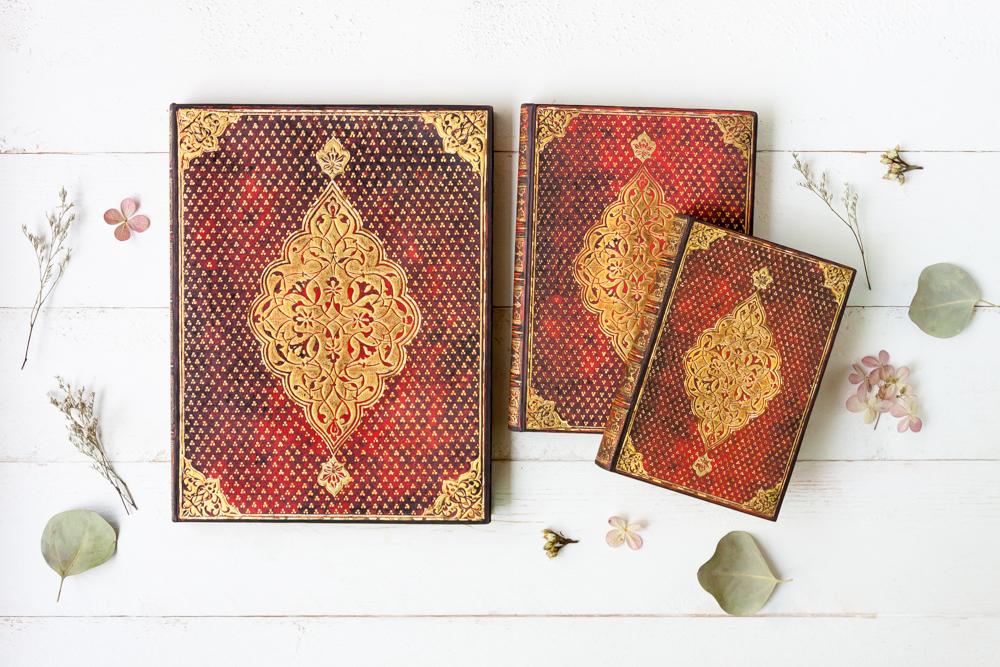 Paperblanks Golden Trefoil journal series in three sizes.
